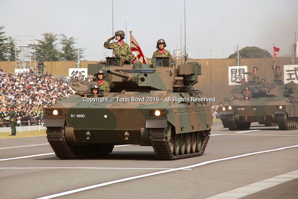 October, 23, 2016, Asaka, Saitama Prefecture, Japan: Armored vehicle units of the Japan Self Defense Force (JSDF) is paraded during an annual military review held at the Asaka Training Area, a JSDF base on the outskirts of Tokyo. For this event, Prime Minister Shinzo Abe, top ranking Japanese military brass and international dignitaries were in attendance to view Japan's military might. This included 4000 troops, 27 divisions, 280 vehicles and artillery, plus 50 aircraft of the Ground, Air, and Maritime branches of the JSDF. (Torin Boyd/Polaris).