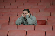 Arsenal fan with head in hands during the Champions League round of 16, game 2 match between Arsenal and Bayern Munich at the Emirates Stadium, London, England on 7 March 2017. Photo by Matthew Redman.