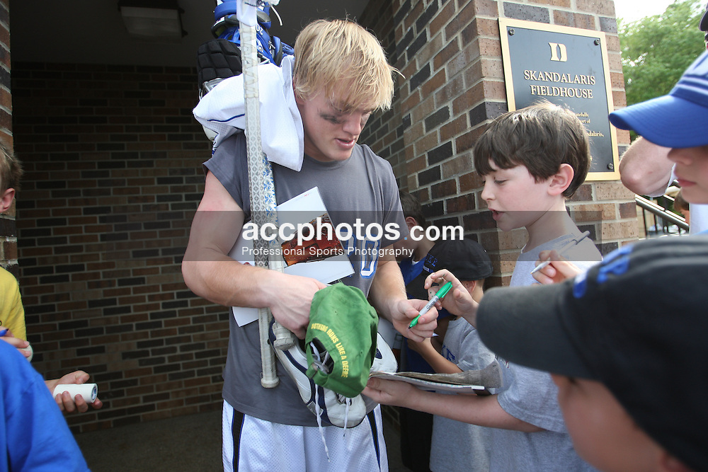 10 May 2008: Duke Blue Devils midfielder Steve Schoeffel (20) signs autographs for fans a 7-12 win over the Loyola Greyhounds during the NCAA First Round at Koskinen Stadium in Durham, NC