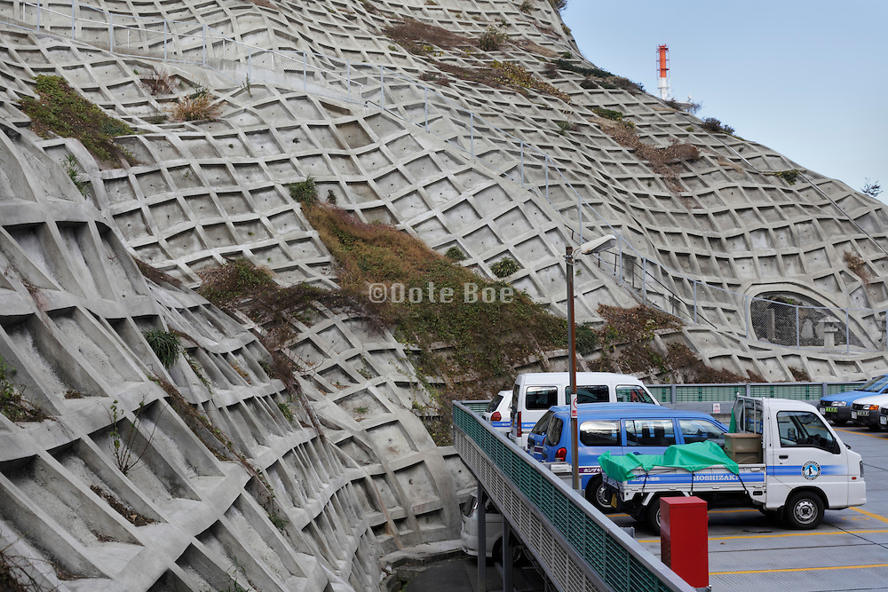 mountain covered with concrete to protect against landslide Japan