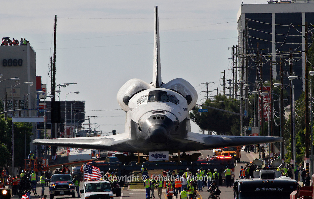 Space Shuttle Endeavour moves down Manchester Avenue while being moved from Los Angeles International Airport to its retirement home at the California Science Center in Exposition Park in Los Angeles, California, October 12, 2012..