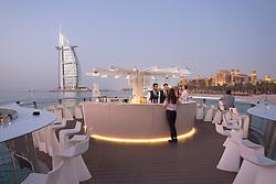 Outdoor bar on pier  in evening at Pierchic restaurant at Al Qasr Hotel Dubai United Arab Emirates