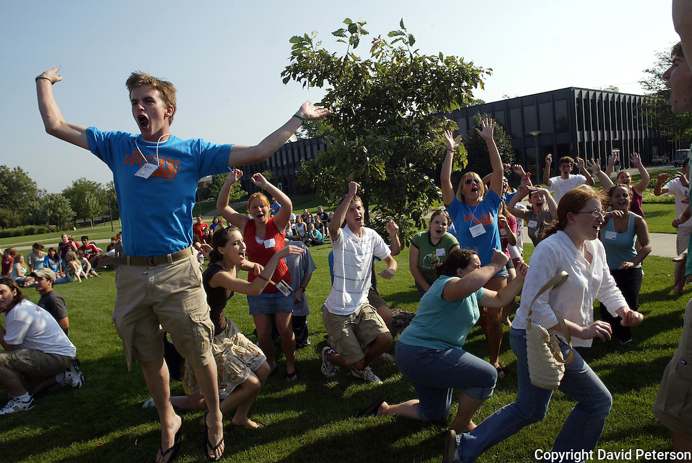 First year students at Drake University in Des Moines, Iowa, show their exuberance during orientation week on the college's campus.  A series of planned activities are scheduled during the week to help the students acclimate to college life and meet other freshmen. orientation,fun,meeting,circle,excitement,exercise,summer,freshmen