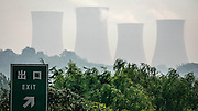 Cooling towers at a coal plant in Luoyang in Henan, China. Pollution due to heavy dependency of coal is only one of China's climate challenges. Warmer weather accelerates desertification of farmland in the north and west, while extreme weather cause flooding, mudslides and jeopardize agriculture in the country. China has more than 11,000 miles of coastline, and a one meter sea level rise could displace as much as 67 million people. With the economic progress comes demand for better living. There were 5 million cars in China in 2000. Now there are more than 120 million.<br /> China have traditionally been holding back on climate negotiations,but in January US and China, the world's biggest greenhouse gas emitters, announced significant commitments to reduce their CO2 emissions within 2030. China is already the world leader in solar and wind power. They still have a long way to go; as of 2011, China produced 70% of its energy from coal, emitted more carbon dioxide than the next two largest countries combined (U.S.A. and India) and emissions had been increasing by 10% a year, according to a study done by chinese and canadian scientists in 2013.