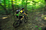 A family enjoys mountain bike trails on private land that is held under a conservation easement, in rural Lancaster County, SC.