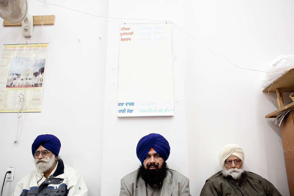 13 February, 2009.Bellerose, Queens, NY.  Three Sikhs listen to preacher Jaswinder Singh at the Gurdwara Sant Sagar Temple. The temple is still in construction and is planned to be completed by mid-April. The temple has been built next to the Veterans of Foreign Wars Hall in Bellerose, Queens, where demographics have changed in recent year.<br /> <br /> &copy;2009 Gianni Cipriano for The New York Times<br /> cell. +1 646 465 2168 (USA)<br /> cell. +1 328 567 7923 (Italy)<br /> gianni@giannicipriano.com<br /> www.giannicipriano.com