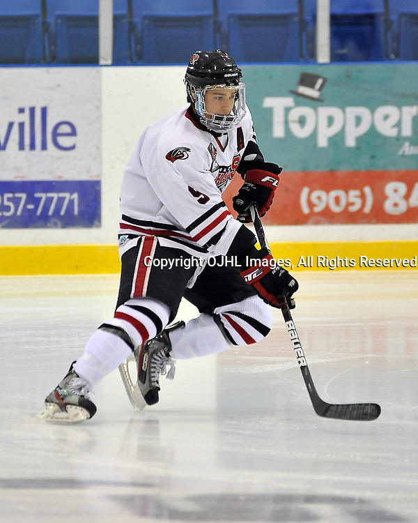 OAKVILLE, ON - Sep 6 : Ontario Junior Hockey League game between Milton Icehawks and Oakville Blades. Opening night of the 2013/2014 season. Kane Elliot #9 of the Milton Icehawks Hockey Club during the pre-game warm-up.<br /> (Photo by Shawn Muir / OJHL Images)