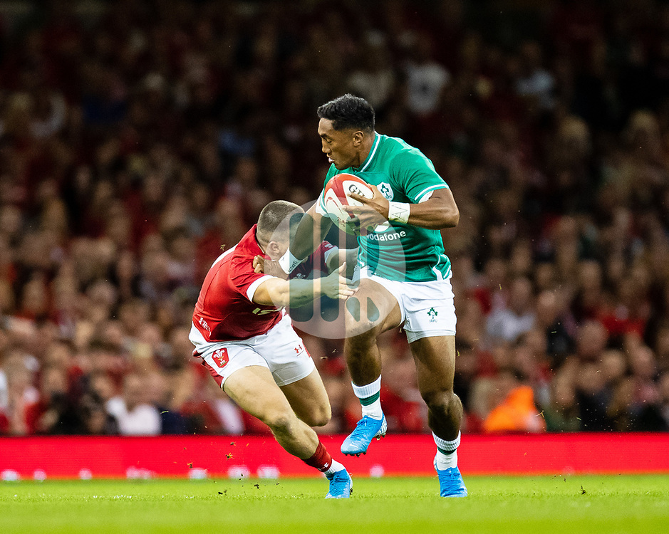 Bundee Aki of Ireland is tackled by Steff Evans of Wales<br /> <br /> Photographer Simon King/Replay Images<br /> <br /> Friendly - Wales v Ireland - Saturday 31st August 2019 - Principality Stadium - Cardiff<br /> <br /> World Copyright © Replay Images . All rights reserved. info@replayimages.co.uk - http://replayimages.co.uk
