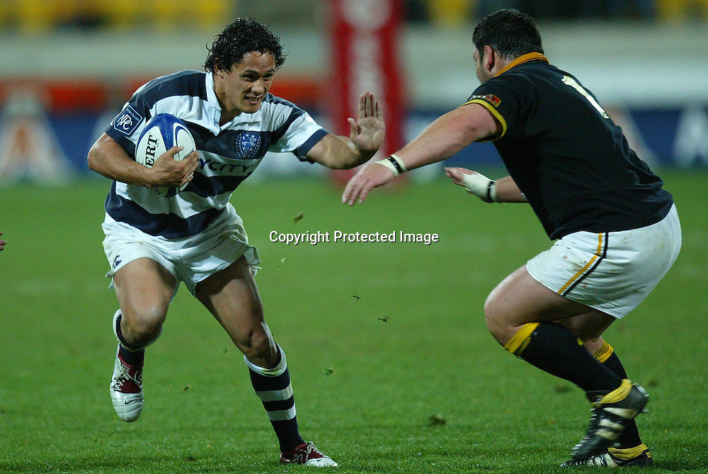 Auckland's Tasesa Laveafends off Lion's Joe McDonnell during the Wellington Lions 27-21 win over Auckland on Saturday night at the Westpac Stadium, Wellington, New Zealand. NPC Div 1 <br /> 11 September 2004<br /> Photo: Marty Melville/Photosport