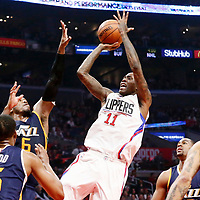 25 March 2016: LA Clippers guard Jamal Crawford (11) takes a jump shot over Utah Jazz forward Joe Johnson (6) and Utah Jazz guard Rodney Hood (5) during the Los Angeles Clippers 108-95 victory over the Utah Jazz, at the Staples Center, Los Angeles, California, USA.