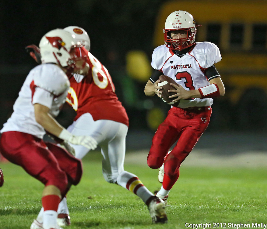 Maquoketa's Blaise Waller (3) eyes Marion's Isaac Frazier (80) on a run during the first half of the game between Maquoketa and Marion at Thomas Park Field in Marion on Friday, September 21, 2012.