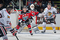 KELOWNA, CANADA - NOVEMBER 21: Joe Gatenby #28 and Jackson Whistle #1 of Kelowna Rockets keep their eye on the puck as Oliver Bjorkstrand #27 looks for the pass to Alex Schoenborn #22 of Portland Winterhawks on November 21, 2014 at Prospera Place in Kelowna, British Columbia, Canada.  (Photo by Marissa Baecker/Shoot the Breeze)  *** Local Caption *** Joe Gatenby; Jackson Whistle; Oliver Bjorkstrand; Alex Schoenborn;