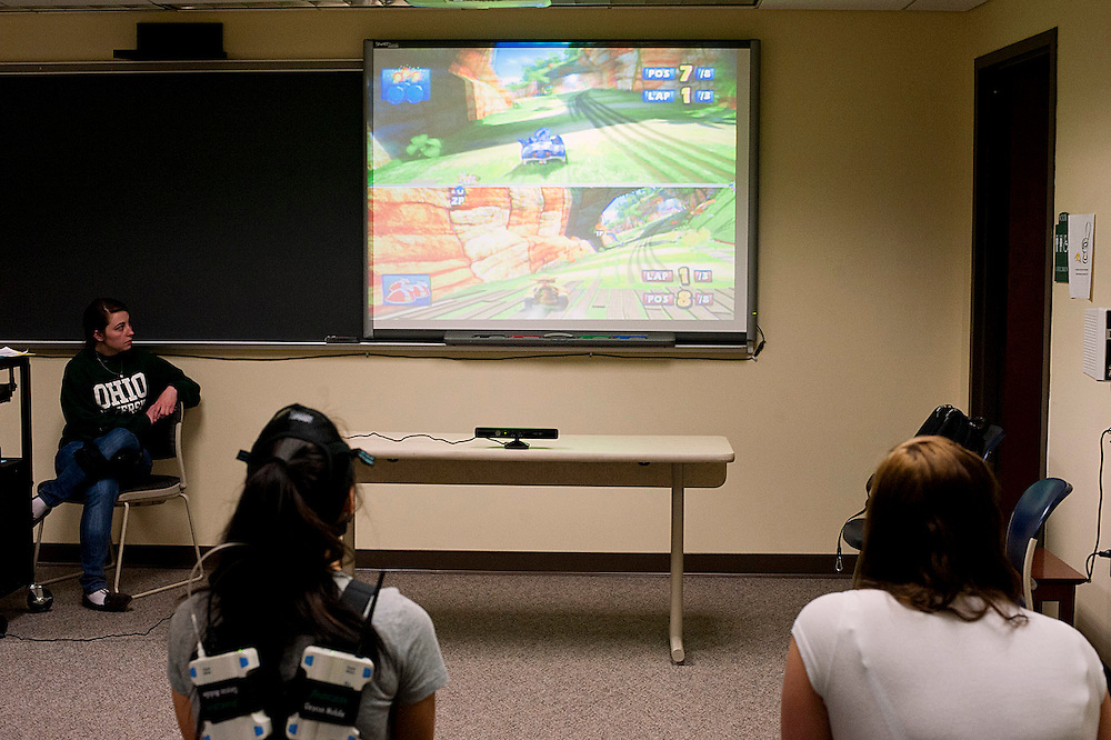Caitlin Laubenthal, an exercise physiology undergraduate, watches Maureen Glismann, left, and Carrie Augenstein play a video game. (photo by Heather Haynes for the Ohio University College of Health Sciences and Professions)