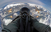 Cockpit Selfies Snapped While Airmen Tear Through the Skies<br /> <br /> Jet fighter pilots around the globe have elevated the selfie phenomenon to astonishing new heights – quite literally. Armed with photographic equipment such as GoPro cameras and fisheye lenses, they've been able to capture dramatic images of themselves on the job – sometimes mid-maneuver or with a stunning backdrop thrown in for good measure. But rather than simply pointing and shooting, these pilots and other flight crew have proven themselves skilled photographers – which is pretty amazing given that they often have a fair few other buttons to press, too.<br /> <br /> Amazing selfie taken by a Swiss Air Force F-18 pilot<br /> The subject's outstretched arms act like an anchor, and two other F-18 jets, one on either side, make the photograph's symmetry practically perfect. It also doesn't hurt that the pilot managed to include an awe-inspiring snow-capped landscape in shot.<br /> ©Swiss Air Force/Exclusivepix Media