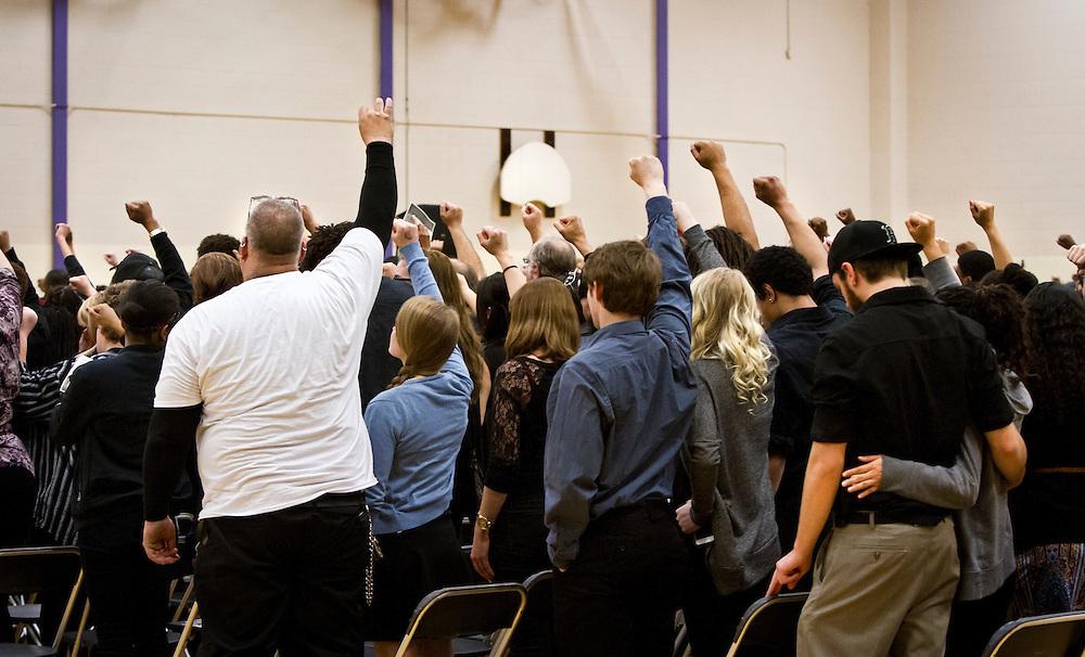 Supporters raise their hands in support during the funeral for Tony Robinson, Jr. at Madison East High School in Madison, Wisconsin, Saturday, March 14, 2015. Hundreds of people gathered on Saturday for the funeral of a 19-year-old man killed by a police officer in Wisconsin's capital on March 6, a shooting that prompted protests over law enforcement's treatment of minorities.  REUTERS/Ben Brewer (UNITED STATES)