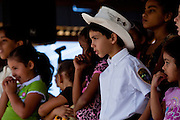 Children watch a singing contest at the Maricao Coffee Festival in Puerto Rico