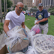 Former New York Yankees All-Star pitcher Mariano Rivera (LEFT) helps volunteers load bags of backpack together during a give-away sponsored by &quot;The Mariano Rivera Public Foundation&quot; Monday, August. 14, 2017, at Rodney Square in Wilmington Delaware. <br /> <br /> More than 1,500 backpacks filled with back-to-school supplies was given to children in grades K through 5th grade.