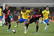 Peru midfielder Renato Tapia (13) and Brazil midfielder Allan (15) battle for the ball during an international friendly soccer match, Tuesday, Sept. 10, 2019, in Los Angeles. Peru defeated Brazil 1-0.