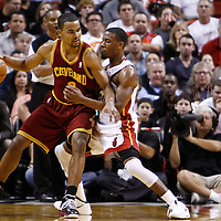 24 January 2012: Miami Heat point guard Norris Cole (30) defends on Cleveland Cavaliers point guard Ramon Sessions (3) during the Miami Heat 92-85 victory over the Cleveland Cavaliers at the AmericanAirlines Arena, Miami, Florida, USA.