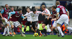 27.02.2011, Upton Park, London, ENG, PL, West Ham United vs Liverpool FC, im Bild Liverpool's Luis Alberto Suarez Diaz is crowded out by West Ham United's James Tomkins and Scott Parker during the Premiership match at Upton Park, EXPA Pictures © 2010, PhotoCredit: EXPA/ Propaganda/ D. Rawcliffe *** ATTENTION *** UK OUT!