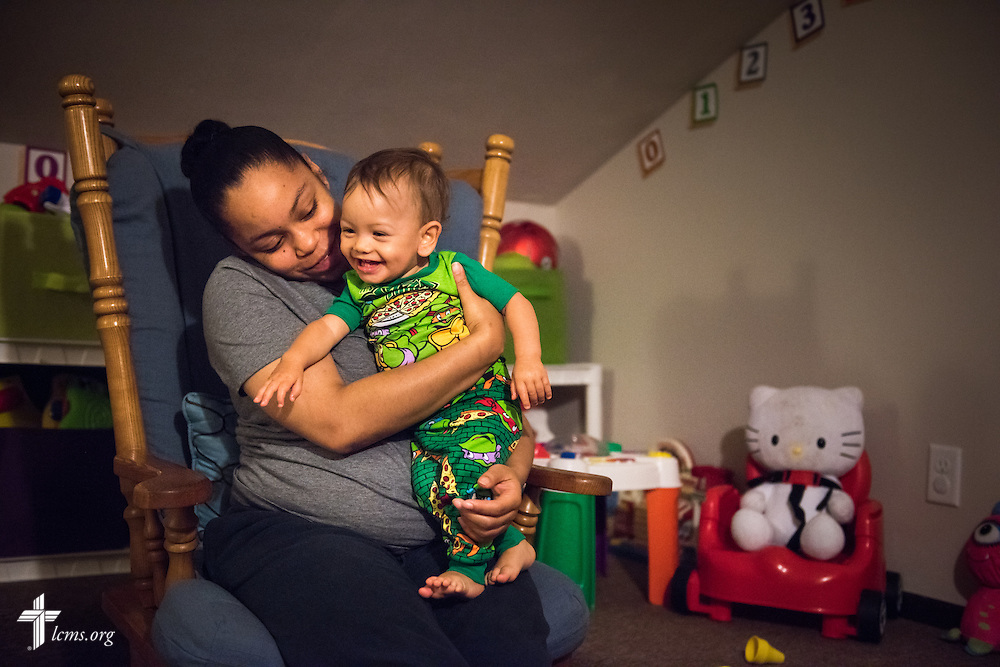 Resident Nyia Harrell wishes Ezekiel Vela a goodnight following  playtime at A Place of Refuge on Tuesday, Sept. 1, 2015, in Milwaukee, Wis. LCMS Communications/Erik M. Lunsford