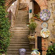 Ceramic urn in doorway, old Deruta, Italy<br />