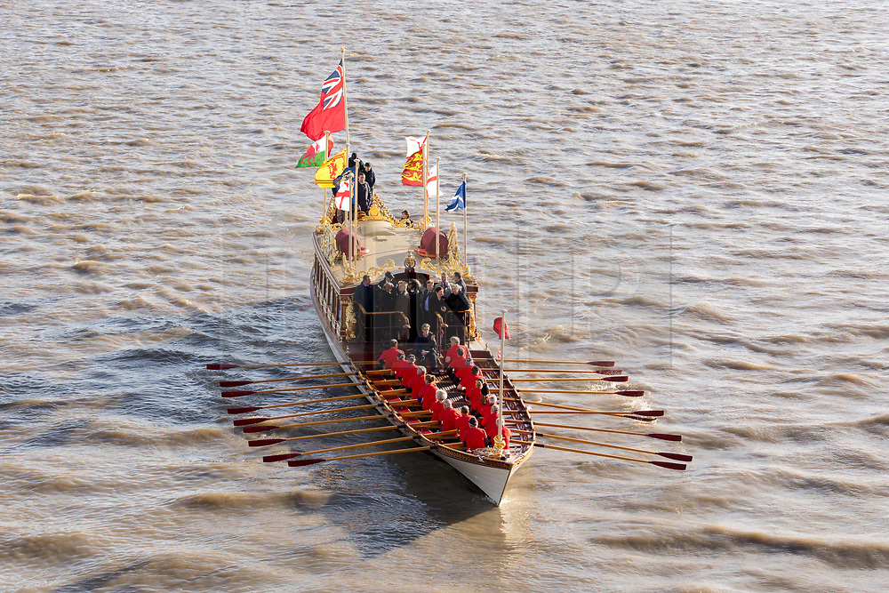 © Licensed to London News Pictures. 11/11/2018. London, UK.   Royal barge, QRB Gloriana in a flotilla of boats including the the Havengore and traditional boats travels up the River Thames towards the Houses of Parliament in Westminster for a remembrance service, led by the Havengore, as part of Armistice Day centenary events taking place in central London. Big Ben will strike at 11am to mark the start of the two minutes silence and the Havengore will sound her horn to signify the end of the two minutes silence in central London.  Photo credit: Vickie Flores/LNP