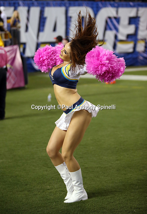 A San Diego Chargers cheerleader waves pom poms as she does a dance routine during the 2015 NFL week 5 regular season football game against the Pittsburgh Steelers on Monday, Oct. 12, 2015 in San Diego. The Steelers won the game 24-20. (©Paul Anthony Spinelli)