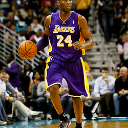 Dec 5, 2012; New Orleans, LA, USA; Los Angeles Lakers shooting guard Kobe Bryant (24) against the New Orleans Hornets during the first quarter of a game at the New Orleans Arena.  Mandatory Credit: Derick E. Hingle-USA TODAY Sports