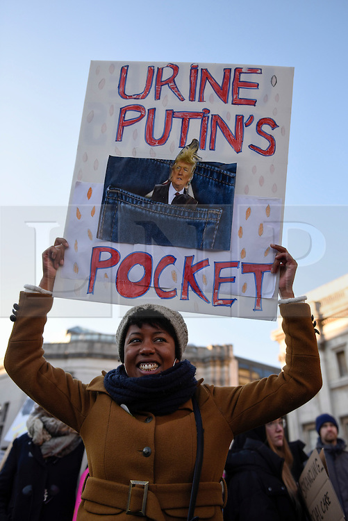 © Licensed to London News Pictures. 21/01/2017. London, UK. Placards held aloft in Trafalgar Square as tens of thousands of women take part in the Women's March in central London.  The event, alongside others taking place worldwide, is a protest against gender inequality. Photo credit : Stephen Chung/LNP