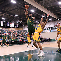 5th year guard Brandon Tull (5) of the Regina Cougars in action during the Men's Basketball home game on January  20 at Centre for Kinesiology, Health and Sport. Credit: /Arthur Images