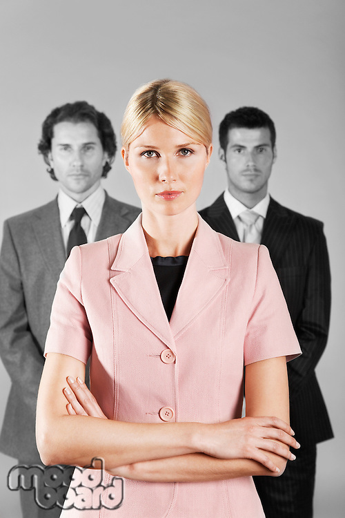 Businesswoman with Businessmen in Background