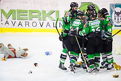 15.12.2013, Hala Tivoli, Ljubljana, SLO, EBEL, HDD Telemach Olimpija Ljubljana vs EHC Liwest Linz, 30th Game Day, in picture Players of HDD Telemach Olimpija celebrates after scoring a goal and teddy bears on the ice during the Erste Bank Icehockey League 53rd Game Day match between HDD Telemach Olimpija Ljubljana and EHC Liwest Linz at the Hala Tivoli, Ljubljana, Slovenia on 2013/12/15. (Photo By Matic Klansek Velej / Sportida)