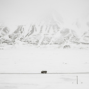 Coal truck hauling a full load of coal between Mine #7 and Longyearbyen, Svalbard, where it's burned for heat and electricity.