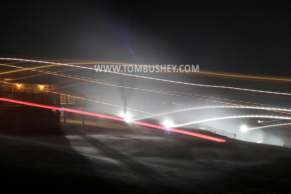 Hamptonburgh, New York  - Snow guns make snow on a windy night at the snow tubing hill at Thomas Bull Memorial Park on Jan. 15, 2012..