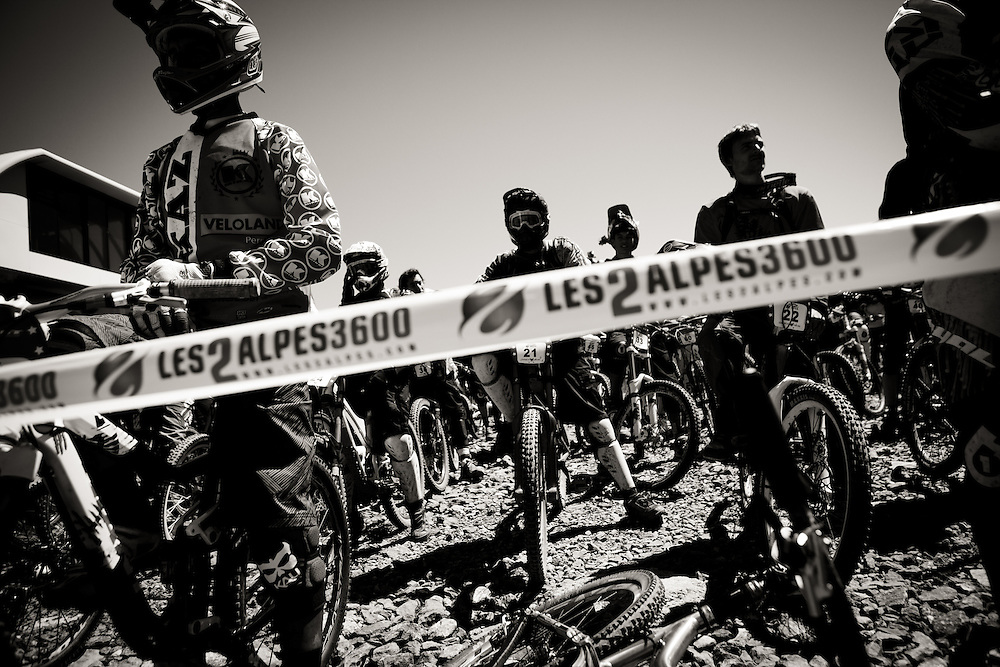 Riders line up at the start line for the Mountain of Hell race, held in Les Deux Alpes, France.