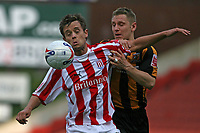Photo: Pete Lorence.<br />Stoke City v Hull City. Coca Cola Championship. 21/04/2007.<br />Lee Hendrie defends the ball from Andy Dawson.