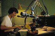 Sylvie Coyaud, presents the weekly program about science Ciclotrone, in the studio of Radio Popolare (Popular Radio) at the headquarter in Santo Stefano square, Milan, 1991. Radio Popolare is an Italian free and indipendent radio station; its programs are broadcasted on FM and streaming and by satellite. &copy; Carlo Cerchioli<br /> <br /> Sylvie Coyaud,presenta la trasmissione di scienza Ciclotrone, nello studio di Radio Popolare nella sede in piazza Santo Stefano, Milano, 1991. Radio Popolare, &egrave; una radio di informazione libera e indipendente; i suoi programmi sono trasmessi in FM e streaming e via satellite.
