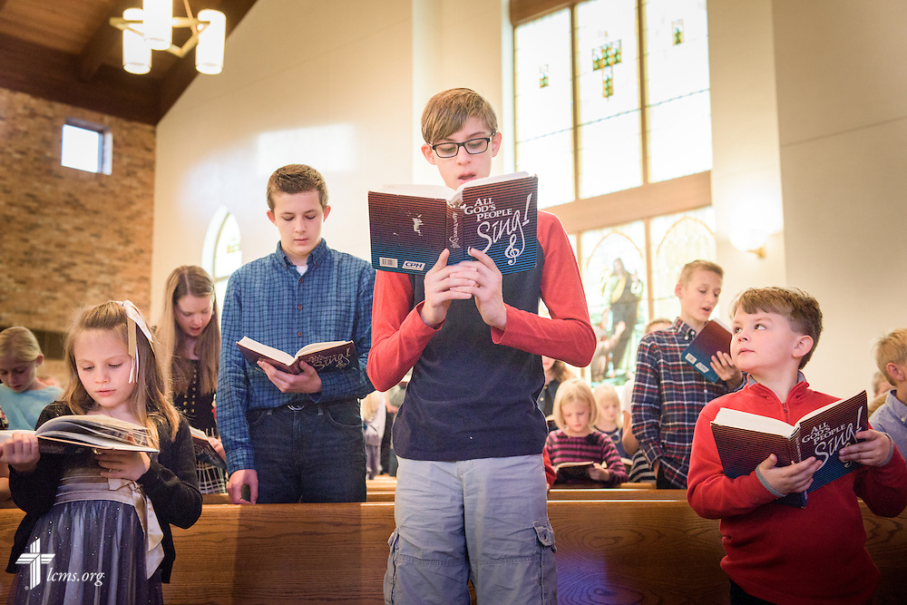 Students standing together from different grades sing during chapel on Friday, Oct. 28, 2016, at First Immanuel Lutheran School in Cedarburg, Wis. LCMS Communications/Erik M. Lunsford