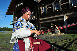 An artisan uses a backstrap loom to create colorful woolens on Kizhi Island, in Russia's Lake Onega. The island is home to the world-famous Transfiguration Church, a timbered marvel with 22 onion domes built without a single nail. Over the years a number of other traditional wooden structures have been moved from Karelia to preserve them, and the island is now a UNESCO World Heritage site.