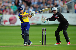 Hamish Marshall of Gloucestershire plays a shot as Craig Kieswetter of Somerset looks on - Photo mandatory by-line: Dan Mullan/JMP - 07966 386802 - 16/05/2014 - SPORT - CRICKET - County Cricket Ground - Gloucester Cricket v Somerset Cricket - T20