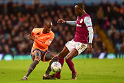 Reading striker Sone Aluko (14) battles for possession  with Aston Villa midfielder Albert Adomah (37) during the EFL Sky Bet Championship match between Aston Villa and Reading at Villa Park, Birmingham, England on 3 April 2018. Picture by Dennis Goodwin.