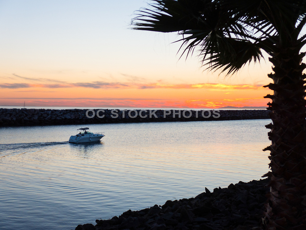 Boating Through the Dana Point Harbor Jetty at Sunset