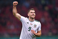 Sam Vokes of Wales national football team celebrates after scoring against Chinese national men's football team in the semi-final match during the 2018 Gree China Cup International Football Championship in Nanning city, south China's Guangxi Zhuang Autonomous Region, 22 March 2018.
