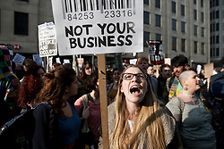 © licensed to London News Pictures. London, UK 14/03/2012. Protesters are shouting outside Dept. for Business, Innovations and Skills (B.I.S.) as the student demonstration against tuition fees and education cuts takes place today in central London. Photo credit: Tolga Akmen/LNP