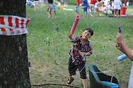 Thomas Franklin plays a game at the 4th of July activities in the Grove in Oxford, Miss. on Thursday, July 4, 2013.