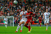 Milton Keynes Dons defender Joe Walsh (4) battles for possession with Liverpool midfielder Alex Oxlade-Chamberlain (15) during the EFL Cup match between Milton Keynes Dons and Liverpool at stadium:mk, Milton Keynes, England on 25 September 2019.