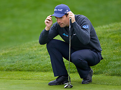 February 12, 2010; Pebble Beach, CA, USA; Padraig Harrington reads a putt on the first hole during the second round of the AT&T Pebble Beach Pro-Am at Pebble Beach Golf Links.