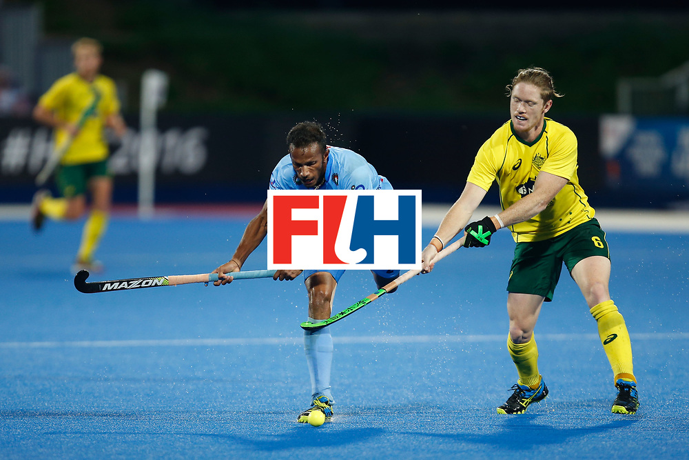 LONDON, ENGLAND - JUNE 17:  Sunil Sowmarpet if India is tripped by Matt Dawson of Australia  FIH Men's Hero Hockey Champions Trophy 2016 final between Australia and India at Queen Elizabeth Olympic Park on June 17, 2016 in London, England.  (Photo by Joel Ford/Getty Images)