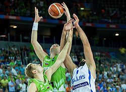 Jaka Blazic of Slovenia and Uros Slokar of Slovenia vs Yannis Bourousis of Greece during basketball match between Slovenia vs Greece at Day 5 in Group C of FIBA Europe Eurobasket 2015, on September 9, 2015, in Arena Zagreb, Croatia. Photo by Vid Ponikvar / Sportida